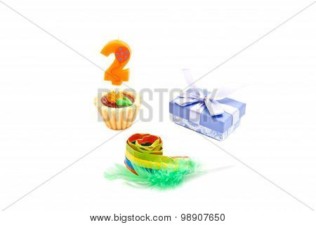 Cake With Two Years Birthday Candle, Whistle And Gift