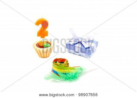 Cake With Two Years Birthday Candle, Whistle And Gift On White