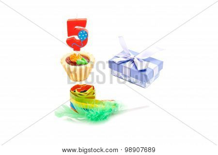 Cake With Five Years Birthday Candle, Whistle And Gift On White