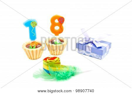 Cakes With Eighteen Years Birthday Candles, Whistle And Gift On White