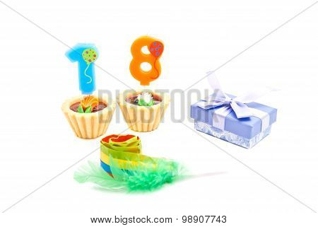 Cake With Eighteen Years Birthday Candles, Whistle And Gift