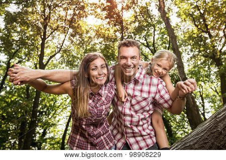 Cheerful Family In The Forest