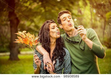 Couple Blowing Dandelion