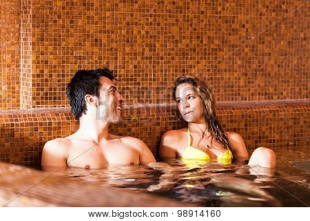 Beautiful couple doing a bath in a spa