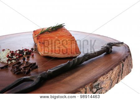 breakfast delicious portion of fresh roast salmon fillet with dry spices garlic rosemary wooden plate black forged handmade fork healthy food diet cooking concept isolated white background empty space