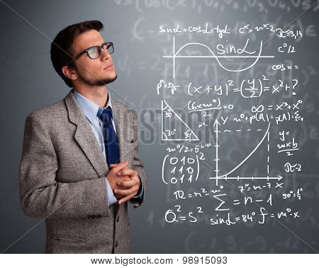 Handsome young school boy thinking about complex mathematical signs
