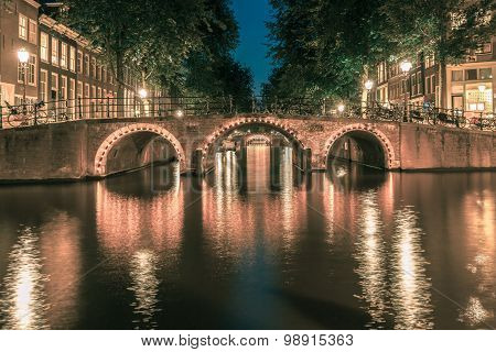 Night Amsterdam canals and seven bridges