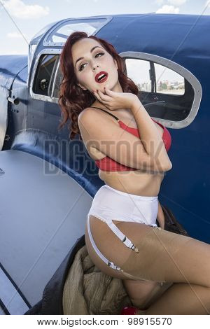 pinup dressed in era of the Second World War, beauty redheaded woman