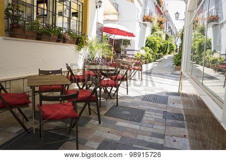 streets of Marbella restaurant tables, Spain