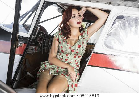 Retro, pinup dressed in era of the Second World War, beauty redheaded woman