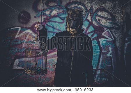 Ugly, man with mask wolf and lamp with colored smoke