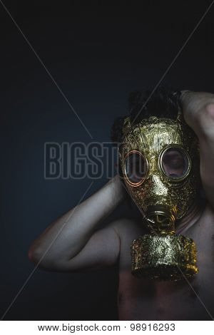 atomic, depression and danger man with golden gas mask
