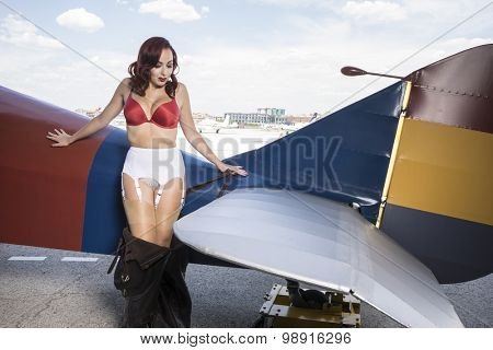 Sexy, dressed in vintage pinup, Spanish civil war, red-haired woman