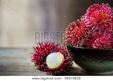 Red Rambutan In Ceramic Bowl