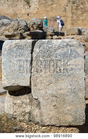 Ancient Greek Text On Lindos Acropolis Stones