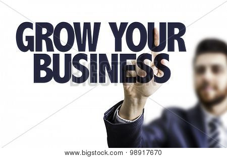 Business man pointing the text: Grow Your Business