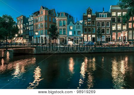 Night Amsterdam canal with dutch houses