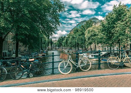 Amsterdam canal, bridge and bicycles