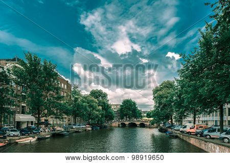 Amsterdam canal, bridge and boats, Holland