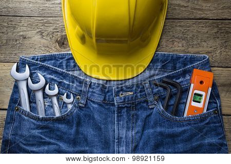 Safety Helmet And Tools In A Jeans Pocket