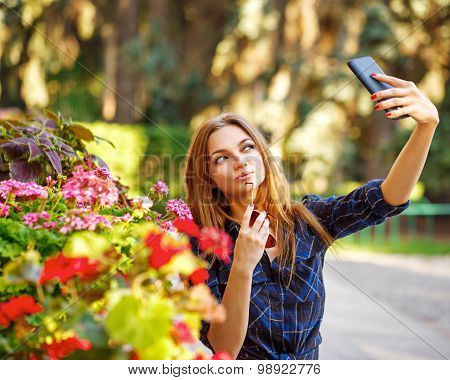 Girl Doing Self-portrait On The Phone. Selfie