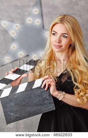 Portrait Of A Girl Director With An Empty Clapperboard