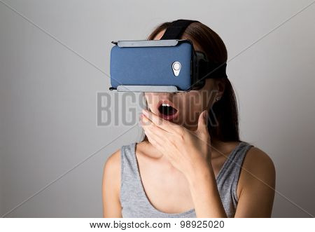 Woman feeling shocking when using the virtual reality device