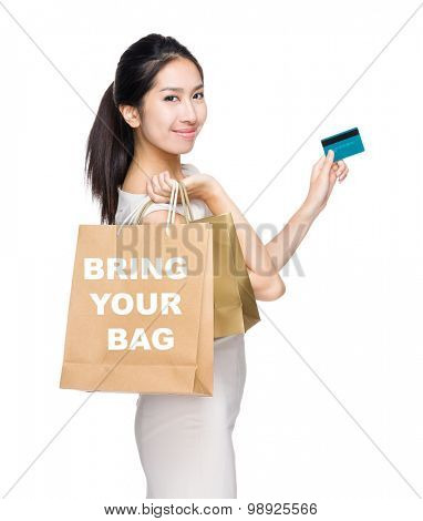 Happy shopping woman credit card and shopping bag for showing bring your bag