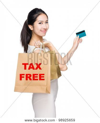 Happy shopping woman credit card and shopping bag for showing tax free