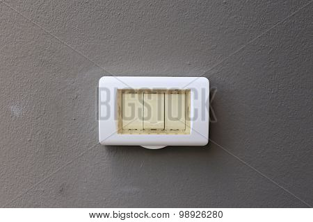 Electronic Light Switch On Gray Mortar Wall