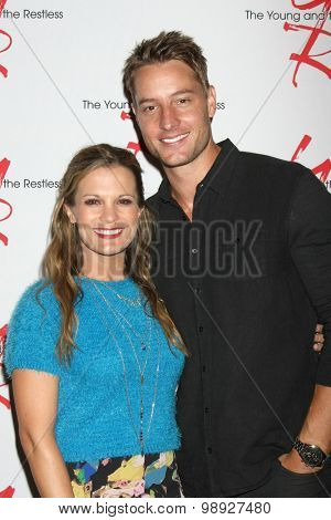 LOS ANGELES - AUG 15:  Melissa Claire Egan, Justin Hartley at the