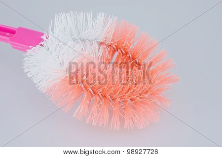 Plastic Orange And White Toilet Brush On White Background