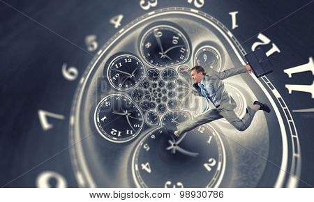 Concept of time with funny businessman running in a hurry