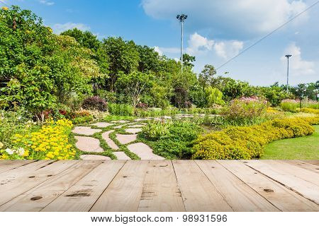 Wood Table And Colour Flower In Garden