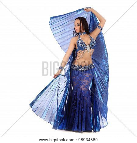 The dancer of belly dance in costume with wings