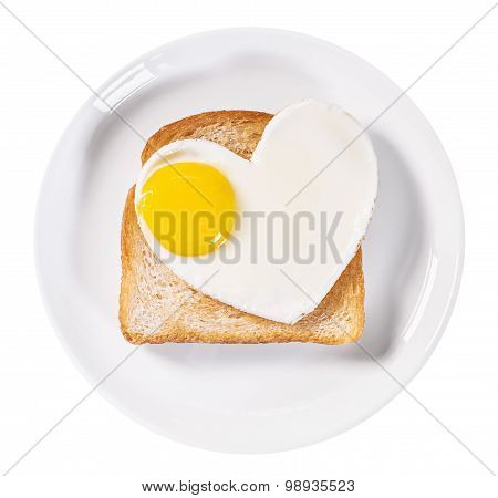 Heart-shaped Fried Eggs And Fried Toast Isolated
