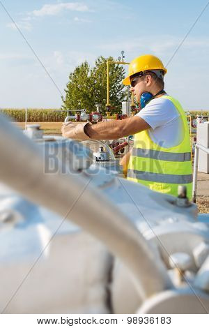 Oil worker in industrial oil