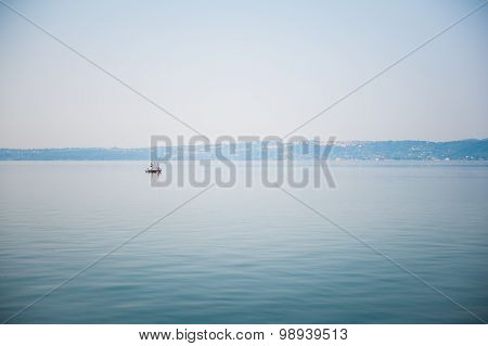 Boat On A Lake In Haze Morning