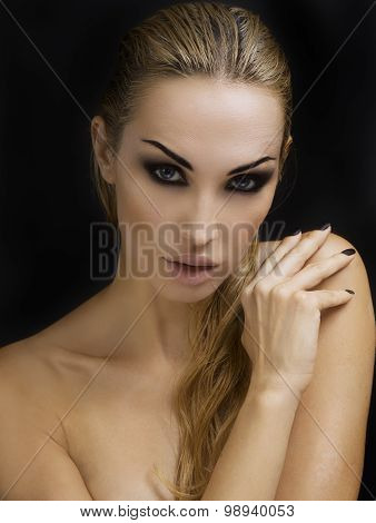 Beautiful Sexy Blond Woman. Dark Background. Bright Smokey Eyes Makeup And Naturally Styled Hair