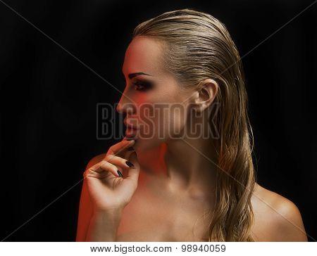 Beautiful Sexy Blond Woman. Dark Background. Bright Smokey Eyes Makeup And Naturally Styled Hair
