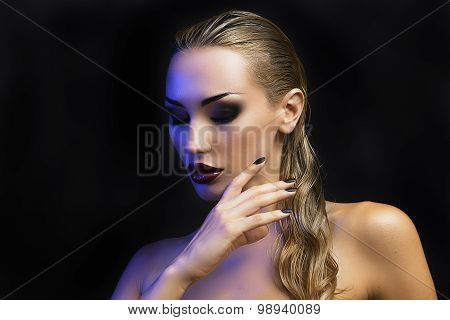 Beautiful Sexy Blond Woman. Dark Background. Bright Smokey Eyes Makeup And Naturally Styled Hair.