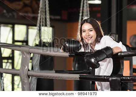 Businesswoman Boxer In Suit And Boxing Gloves On Boxing Ring  Smiling Happy. Beautiful Asian