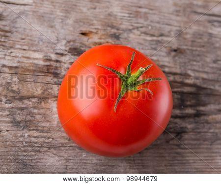 One Ripe Tomato On Wood Background