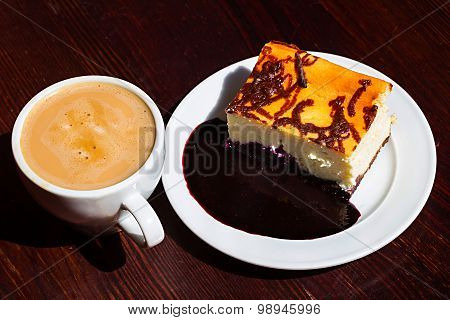 Slice Cheesecake With Blueberry Jam And Cup Of Americano Coffee
