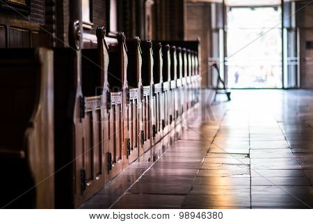Wooden Pews In A Row In A Church