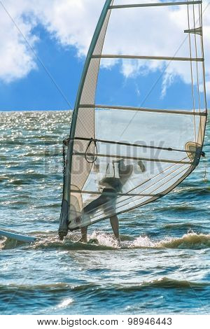 Windsurfing On The Background Of Blue Sea