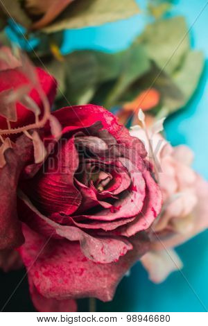 Red Roses With A Picture At Close Range.