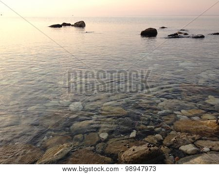 Calm Waters By The Ocean Background With A Few Rocks In Thassos Greece