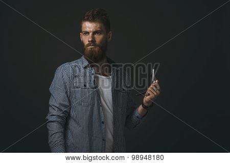 Portrait Of Bearded Man With Straight Razor