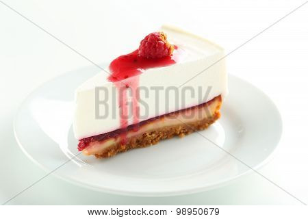 Fresh Raspberry Cheesecake On White Plate